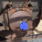RotoSense sensor module (blue) mounted on train axle hub